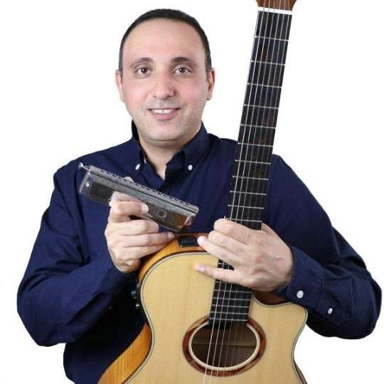 Iman RP Guitar and Harmonica Instructor