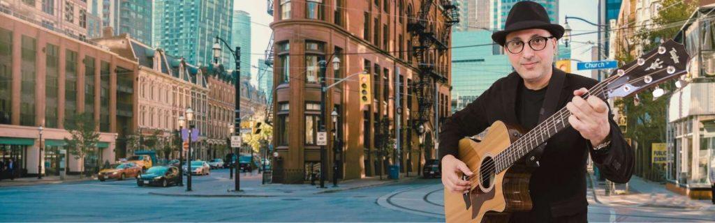 Toronto-online-Guitar-Lessons-Iman-Music-Studio---Iman-RP-Plays-Taylor-Guitar-in-Toronto